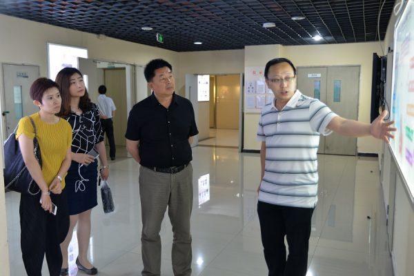 秦皇岛市民政局副局长丁利一行到国贸中心调研